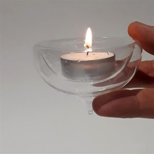 Floating tealight candle holder
